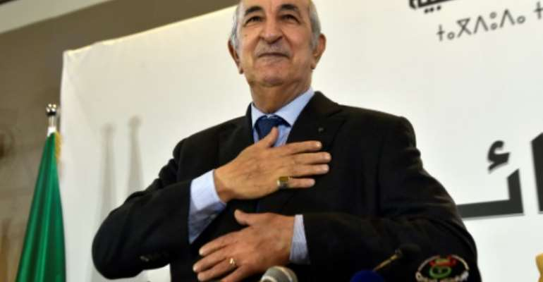 President Abdelmadjid Tebboune has demanded 'total respect' from France before Algeria returns its ambassador to Paris.  By RYAD KRAMDI (AFP/File)
