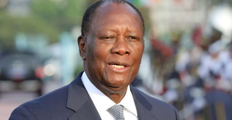 President Alassane Ouattara had previously kept Ivorians guessing over his political future.  By Ludovic MARIN (AFP/File)