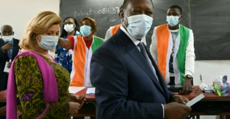 President Alassane Ouattara, shown here voting with his wife, won with more than 94 percent of the vote.  By Issouf SANOGO (AFP/File)