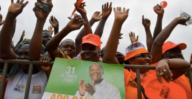 President Alassane Ouattara's candidacy defying a constitutional 2-term limit was cheered by supporters but led to violent protests.  By Issouf SANOGO (AFP/File)