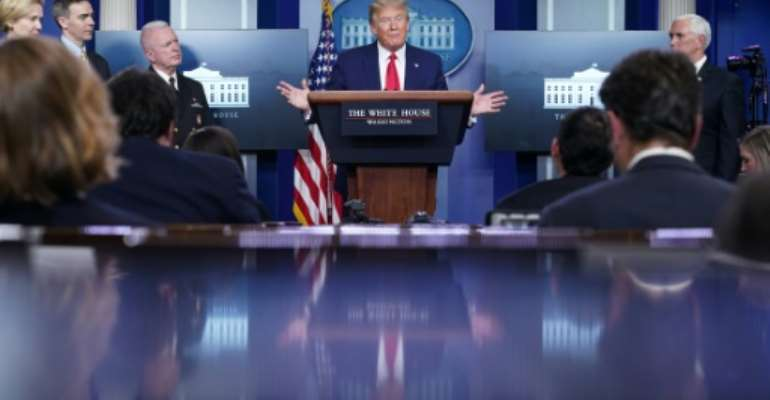 President Donald Trump speaks during the daily briefing on the novel coronavirus. He suspends immigration insisting he is protecting American jobs but critics say he is appealing to his base in an election year.  By MANDEL NGAN (AFP)