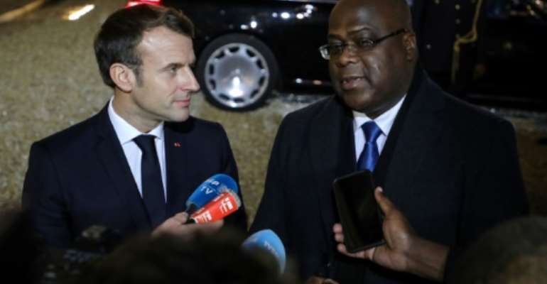 President Emmanuel Macron, left, told DRC counterpart Felix Tshisekedi that France would extend military support to fight armed groups.  By ludovic MARIN (AFP)