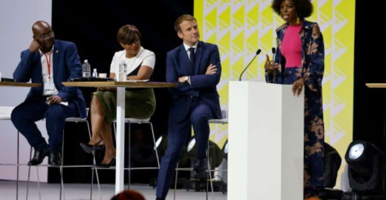 President Emmanuel Macron listened as Adelle Onyango of Kenya assailed France's 'denial' of its colonial past.  By Ludovic MARIN (AFP)
