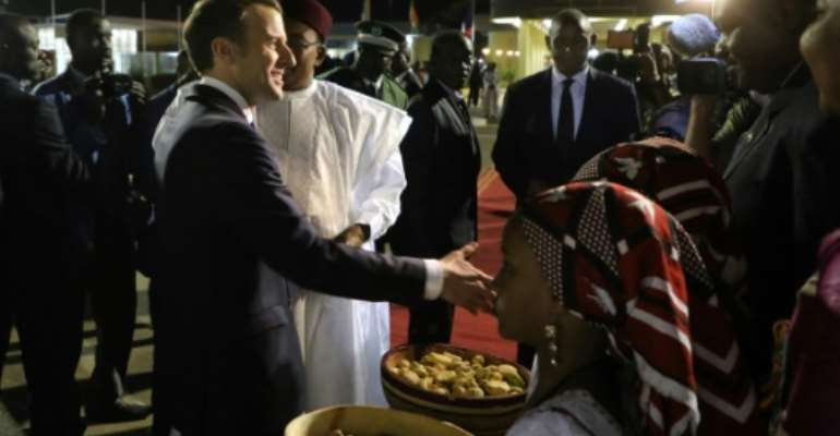 President Emmanuel Macron will have a special Christmas dinner with French troops made by a chef from the Elysee.  By Ludovic MARIN (AFP)