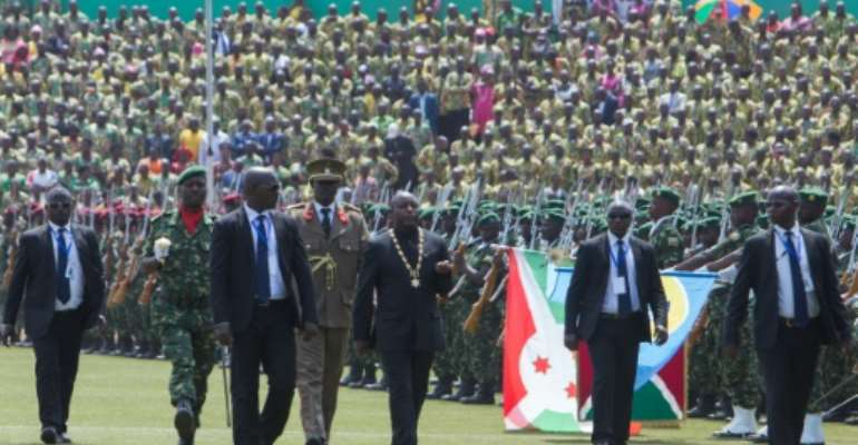 President Evariste Ndayishimiye, third from the right, at his swearing-in ceremony last June.  By TCHANDROU NITANGA (AFP)