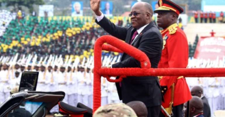 President John Magufuli, centre, at ceremonies last December to mark Tanzania's 58th anniversary of independence.  By STRINGER (AFP)