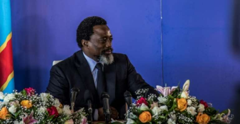 President of the Democratic Republic of Congo Joseph Kabila, pictured in January 2018, has received calls from the US, France and Britain to clearly state that he will step aside and allow for a peaceful transfer of power in December.  By THOMAS NICOLON (AFP/File)