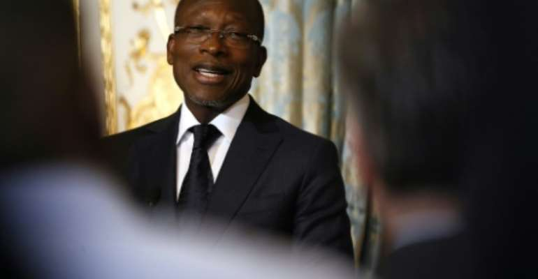 President Patrice Talon, a former business tycoon, has been accused of cracking down on opponents.  By Etienne LAURENT (POOL/AFP)