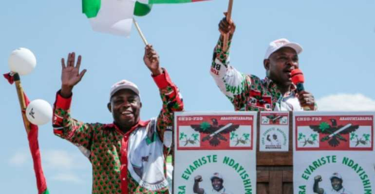 President Pierre Nkurunziza, right, and his hand-picked successor Evariste Ndayishimiye at a rally ahead of last week's elections.  By - (AFP/File)