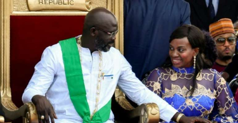 President Weah and his wife Clar, pictured at his inauguration in January 2018.  By ISSOUF SANOGO (AFP)