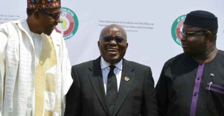 Presidents Muhammadu Buhari of Nigeria (L), Nana Akufo-Addo of Ghana (C) and Julius Maada Bio of Sierra Leone were among the leaders meeting in Ouagadougou.  By ISSOUF SANOGO (AFP)