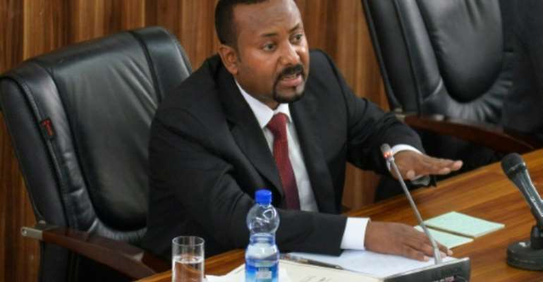 Prime Minister Abiy Ahmed, speaking in parliament in February.  By MICHAEL TEWELDE (AFP)