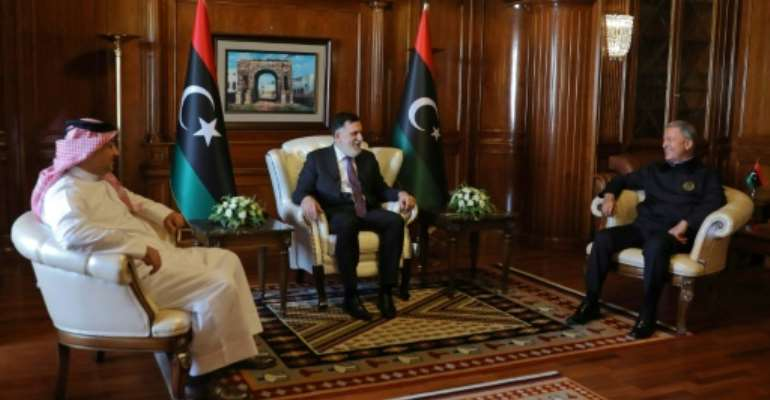 Prime Minister of Libya's UN-recognised Government of National Accord (GNA) Fayez al-Sarraj (C) meets with Turkish Defence Minister Hulusi Akar (R), and his Qatari conterpart Khaled bin Mohammad Al-Attiyah (L) in the capital Tripoli.  By - (AFP)