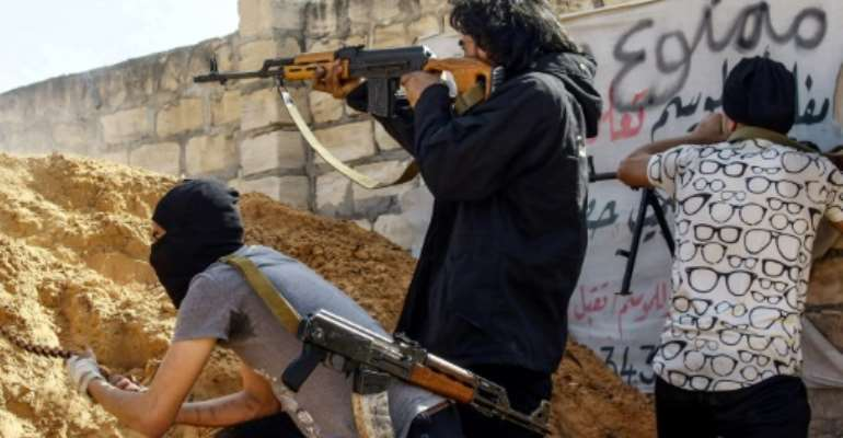 Pro-government forces are battling fighters from commander Khalifa Haftar's self-styled Libyan National Army.  By Mahmud TURKIA (AFP/File)