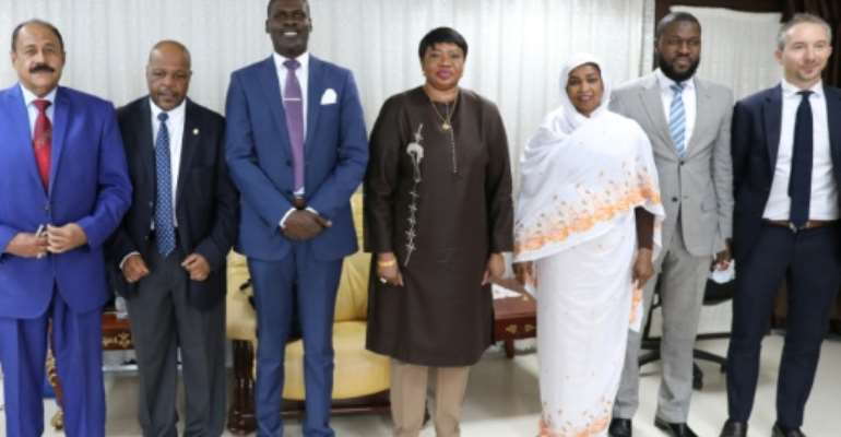 Prosecutor of the International Criminal Court, Fatou Bensouda (C), poses with Sudanese officials, including Justice Minister Nasruddin Abdel Bari (3rd L), during her visit to Khartoum.  By - (AFP)
