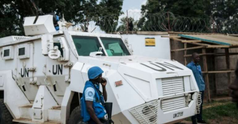 Protection: A MONUSCO armoured vehicle guarding the Ebola response headquarters in the violence-torn eastern city of Beni.  By ALEXIS HUGUET (AFP)