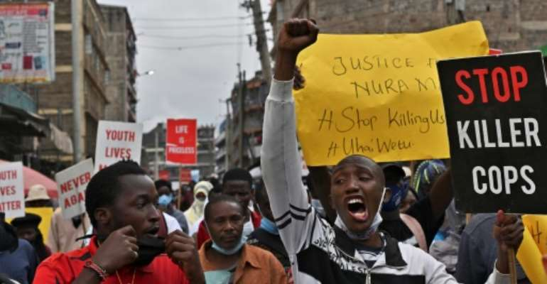Protest: Residents of Mathare demonstrate against police violence.  By TONY KARUMBA (AFP)