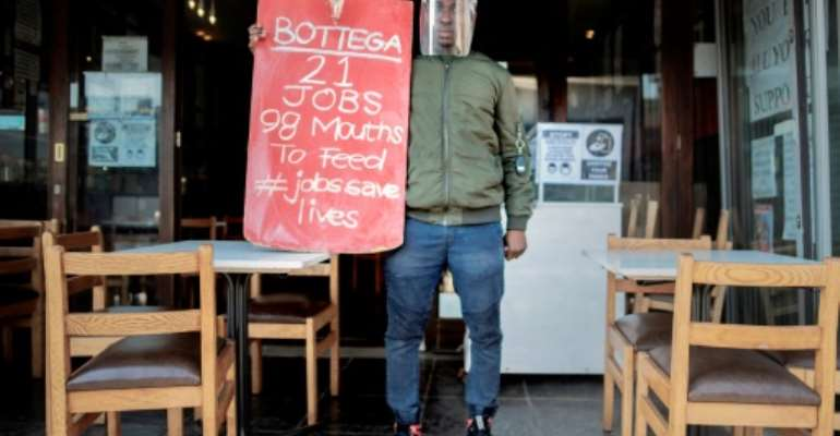 Protest: South Africa's restaurant industry says a night-time curfew and a ban on alcohol are destroying business.  By Luca Sola (AFP)