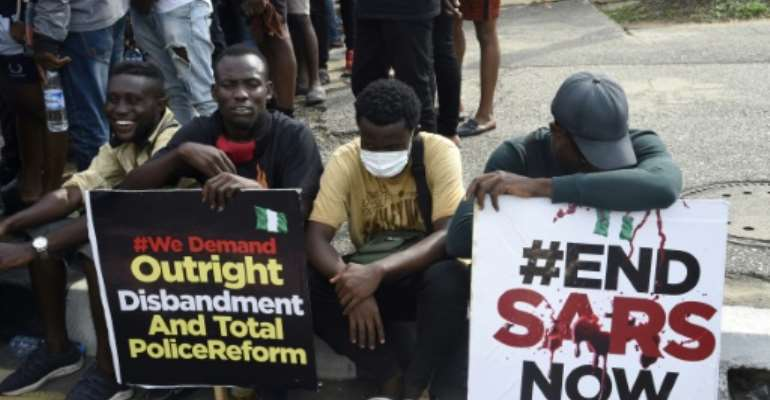 Protesters at a march last week -- they have vowed to keep up pressure after previous pledges to disband the SARS police unit were not honoured.  By PIUS UTOMI EKPEI (AFP/File)