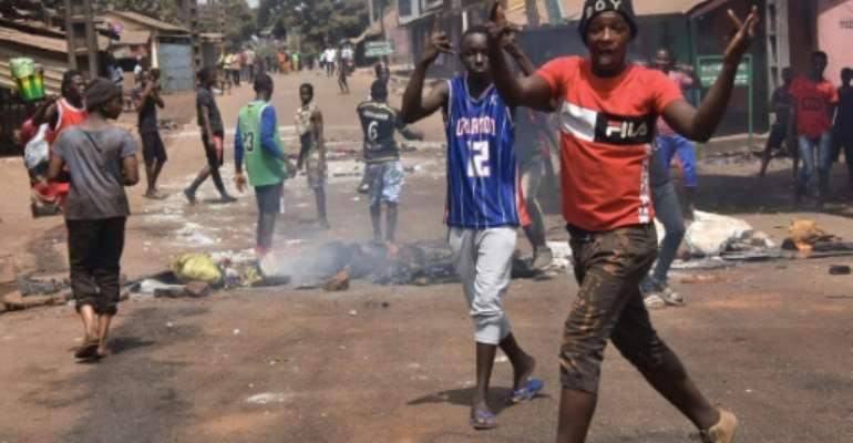 Protesters burn rubbish and block roads along the