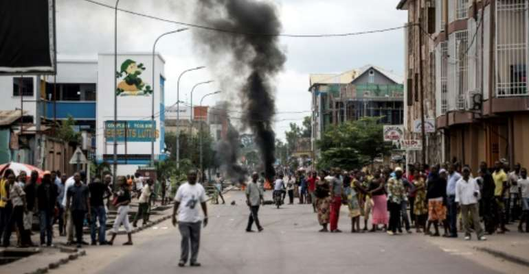Protesters burn tyres during a demonstration calling for Joseph Kabila to step down.  By JOHN WESSELS (AFP/File)