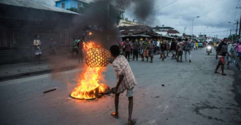 Protesters burned tyres, blocked roads and threw stones at security forces.  By RIJASOLO (AFP)