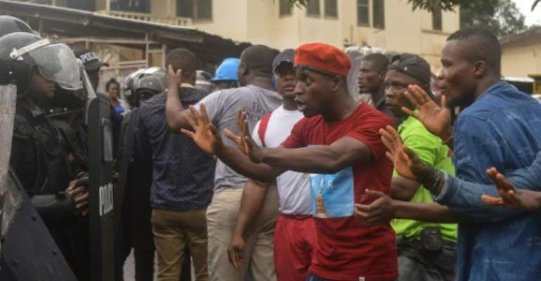 Protesters, calling for the government to improve living conditions, clashed with police in Monrovia on Wednesday.  By Zoom DOSSO (AFP)