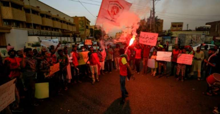 Protesters demonstrated in the Sudanese capital Khartoum in solidarity with rallies in the Central Darfur town of Nertiti demanding the government beef up security in the region.  By ASHRAF SHAZLY (AFP/File)