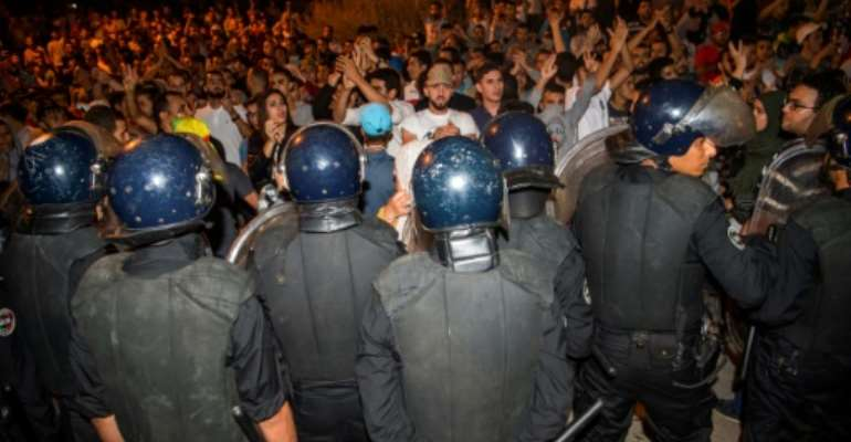 Protesters face security forces during a demonstration against corruption and employment in the northern Rif region, June 8, 2017 in Al Hoceima, Morocco.  By FADEL SENNA (AFP)
