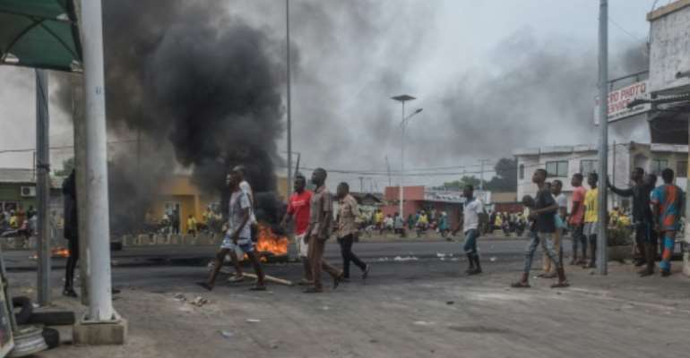 Protesters gather on the streets of Cadjehoun, the stronghold of former president of Benin Thomas Yayi Boni, on May 2, 2019 in Cotonou, Benin.  By Yanick Folly (AFP/File)