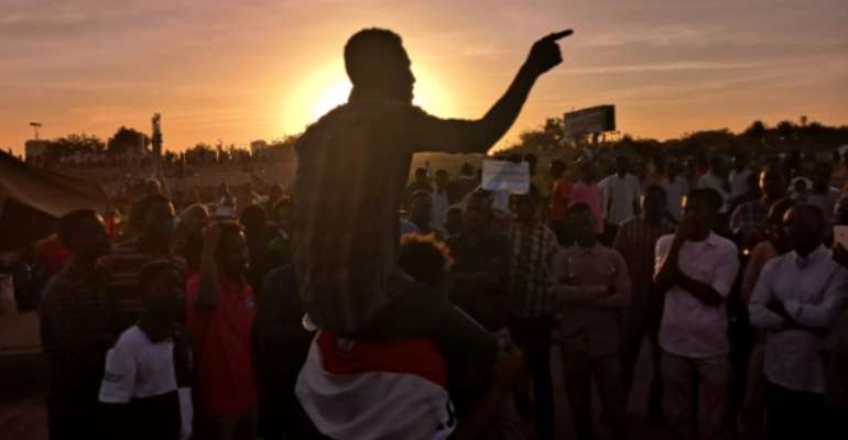 Protesters have been camped for several weeks in front of important government buildings throughout Sudan.  By Ashraf SHAZLY (AFP)