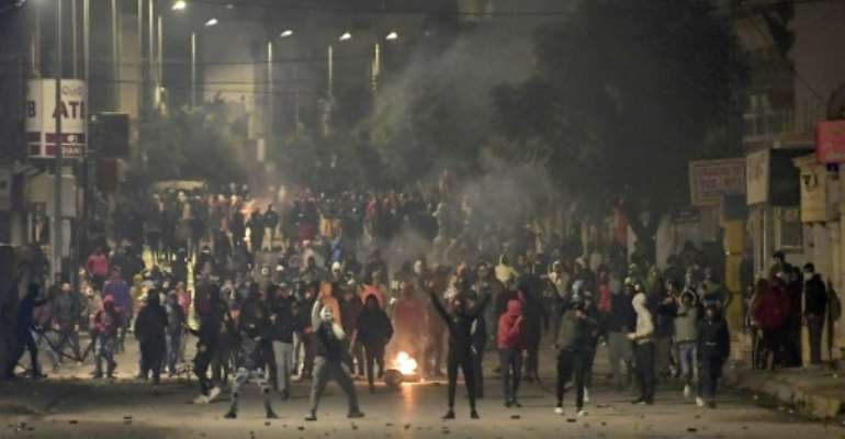 Protesters in Tunisia clashed with police in the Ettadhamen suburb of Tunis on Tuesday night.  By FETHI BELAID (AFP)