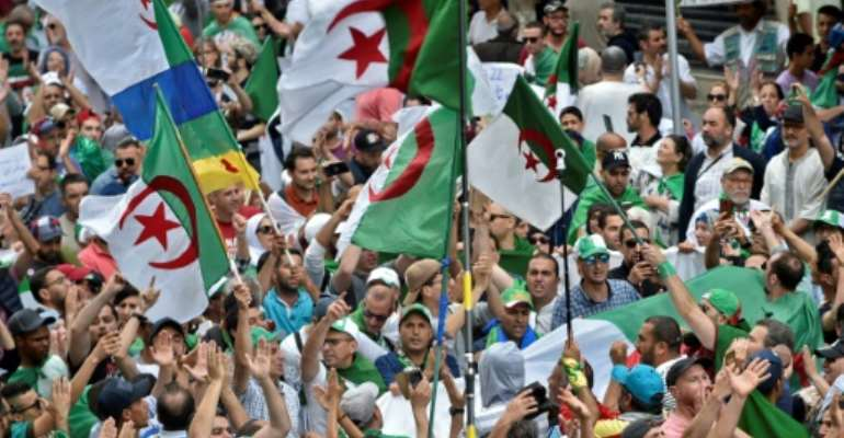 Protesters insist that a vote held under Algeria's current authorities would not be legitimate.  By RYAD KRAMDI (AFP)