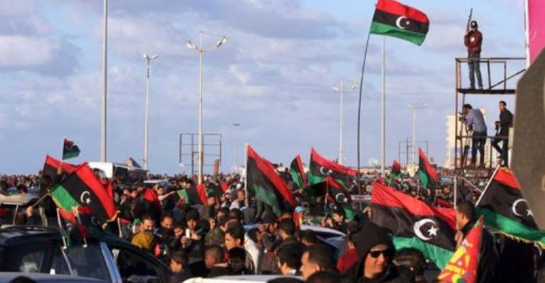Libyans celebrate the second anniversary of the uprising against Kadhafi, on February 17, 2013, in Benghazi.  By Abdullah Doma (AFP/File)