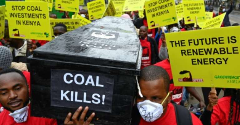 Protesters march in downtown Nairobi to demonstrate against a coal-fired power station planned for Kenya's heritage-listed Lamu archipelago.  By SIMON MAINA (AFP)