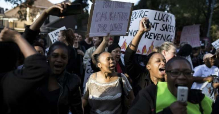 Protesters rallied outside Johannesburg Stock Exchange.  By GUILLEM SARTORIO (AFP)