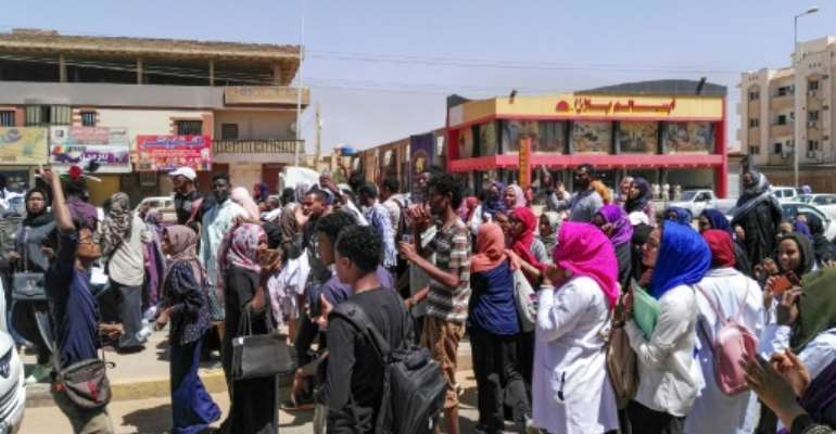 Protesters shout slogans during an anti-government demonstration in Street 60 in the Sudanese capital Khartoum.  By - (AFP)