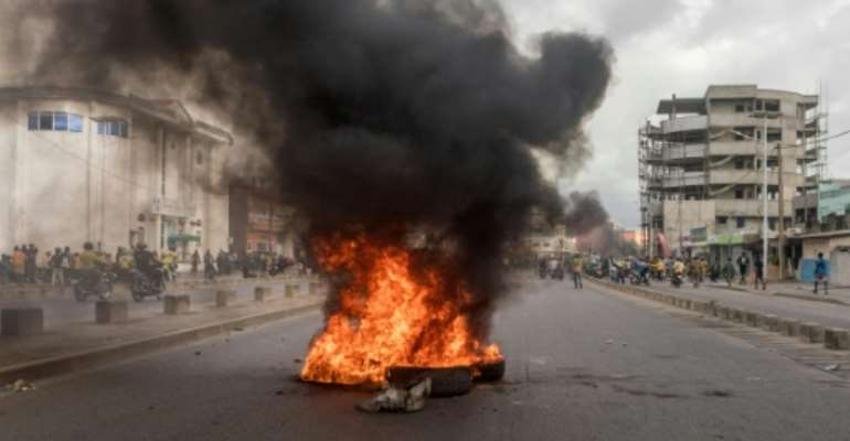 Protestors in Benin set up burning barricades on the streets.  By Yanick Folly (AFP)