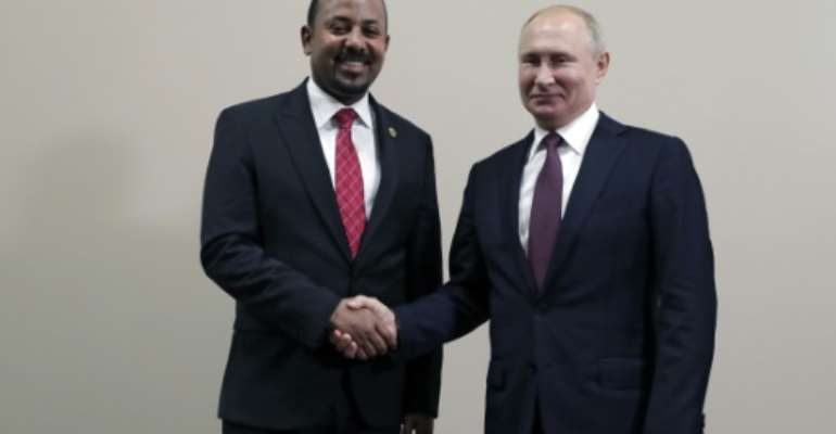 Protests against Abiy Ahmed, this year's Nobel Peace Prize laureate, erupted in Addis Ababa and in Ethiopia's Oromia region after an activist accused security forces of trying to orchestrate an attack against him; pictured October 23 2019 with Russian President Vladimir Putin.  By Mikhail METZEL (SPUTNIK/AFP)