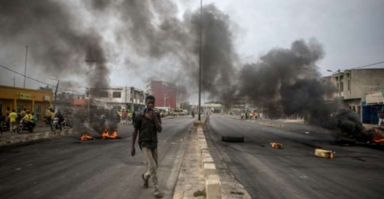 Protests began hours after initial results showed a record low turnout in Sunday's election in Benin.  By Yanick Folly (AFP)