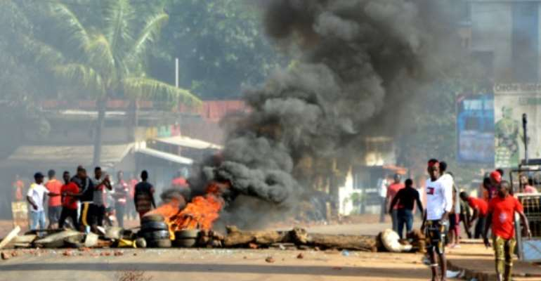 Protests have rocked Conakry and other cities earlier this month over Conde's bid to overturn term limits and run again.  By CELLOU BINANI (AFP)