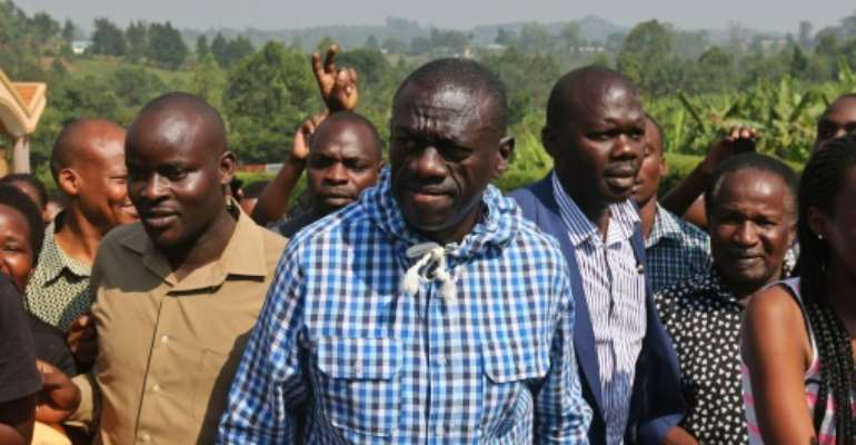 Kizza Besigye (centre), who has rejected President Yoweri Museveni's February 18 election victory, said he was trying to attend a prayer meeting at his Forum for Democratic Change (FDC) party headquarters.  By  (AFP/File)