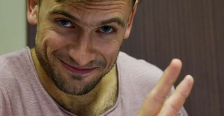 Pussy Riot punk group member Pyotr Verzilov was probing three Russian reporter's deaths when he fell ill, his estranged wife says.  By Vasily MAXIMOV (AFP/File)