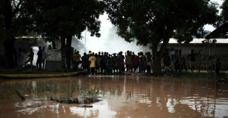 Rains have pounded the Central African Republic for several days, causing the Oubangui River and its tributaries to overflow.  By FLORENT VERGNES (AFP)