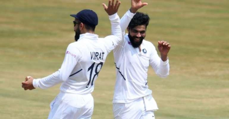 Ravindra Jadeja (right) celebrates with captain Virat Kohli after the dismissal of South Africa's Aiden Markram.  By NOAH SEELAM (AFP)