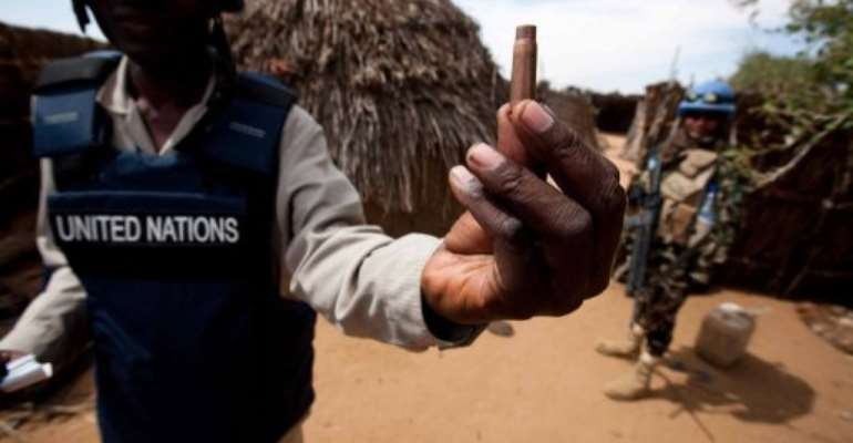 A UN officer holds a spent cartridge left behind by militants who attacked a village in Darfur, November 6, 2012.  By Albert Gonzalez Farran (UNAMID/AFP/File)