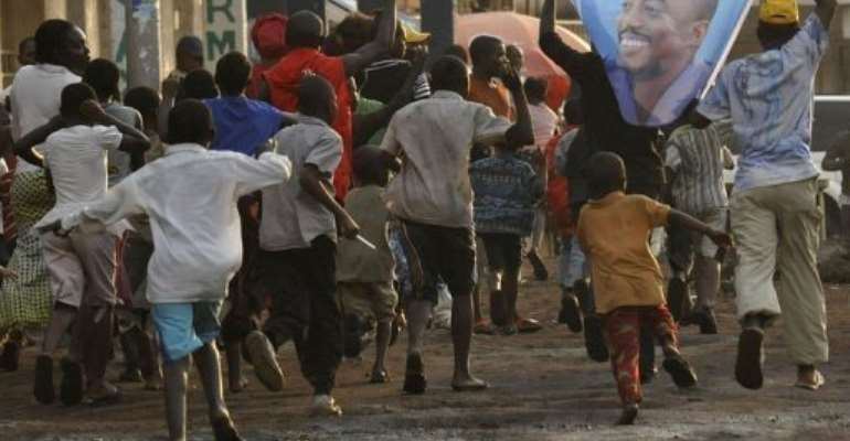 Joseph Kabila's supporters celebrate in Goma on December 9 after he was declared re-elected.  By Simon Maina (AFP/File)