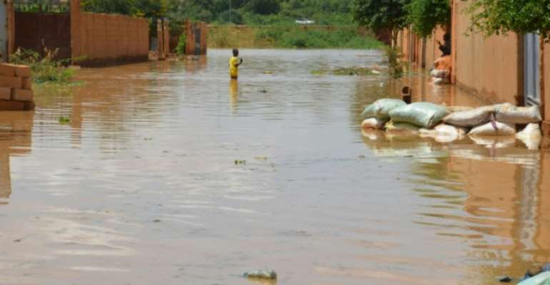 Relentless floods have battered several parts of the city and the rest of the country.  By BOUREIMA HAMA (AFP)