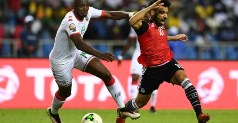 Renaissance Berkane defender Issoufou Dayo (L) challenges Mohamed Salah while playing for Burkina Faso against Egypt in a 2017 Africa Cup of Nations semi-final..  By GABRIEL BOUYS (AFP)