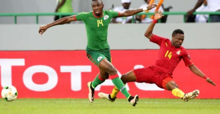 Renaissance Berkane match-winner Issoufou Dayo (L) playing for Burkina Faso against Ghana in the 2017 Africa Cup of Nations.  By Steeve JORDAN (AFP/File)